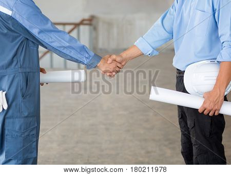 Close up group of Construction Asian civil engineer and foreman shake up their hand after achieve their mission or construction.