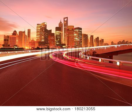 Empty road surface with Shanghai Bund Lujiazui modern city buildings backgrounds Dawn