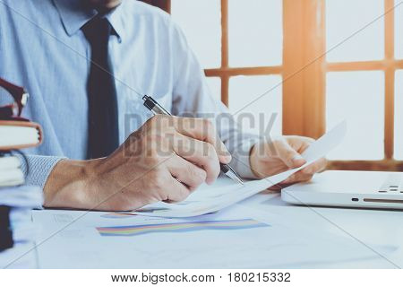 Businessman analyzing investment charts. Close up.Financial Report Revenue Statistical Accounting Concept.