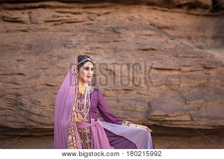 Persia or Iran Women's in persia traditional dress rock background