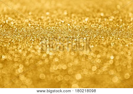 Abstract gold glitter sparkle confetti background or golden party invite for happy birthday, 50th anniversary backdrop, New Year's Eve ad, fashion sequins, Christmas bokeh, engagement or bridal design