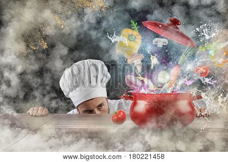 Amazed chef looks an explosion of ingredients in a pot