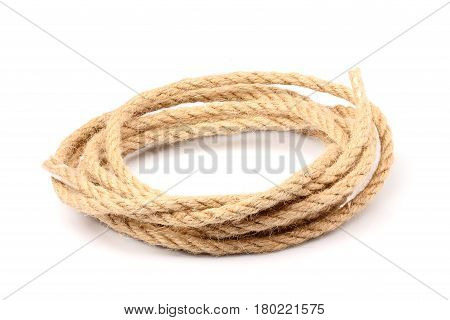 Wound the rope in a circle isolated closeup on white background.