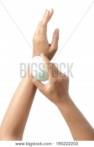 Hygiene and health care topic of woman's hands holding green soap isolated on white background clipping path.