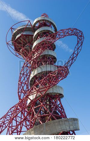 London, England - October 17, 2016; ArcelorMittal Orbit red tubular steel abstract looking structure spiraling skyward with silver outer walkway and stainless steel steel slide curling down at 114.5 meter London's tallest sculpture a popular tourist attra