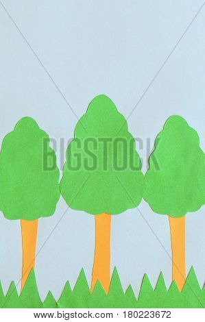 Paper trees applique with empty space for text. Earth day card. Children's application of colored paper on Earth day