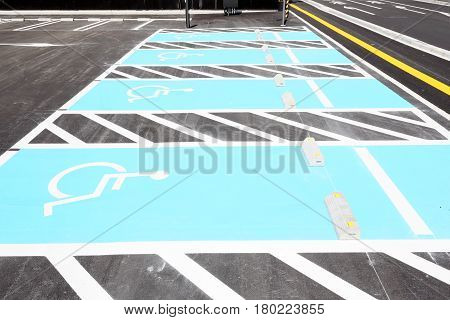markings for a handicapped parking stall in a parking lot