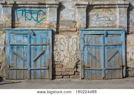 Large vintage barn doors with obsolete blue paint