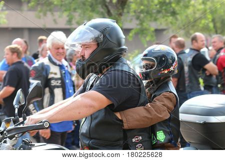 Father And Small Boy On Motorbike At Yearly Mass Ride