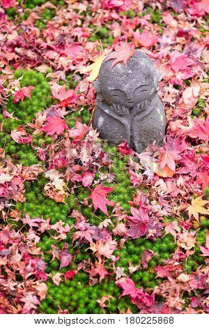 Cute Stone Sculpture Doll And Maple Leaves At Enkoji Temple, Kyoto, Japan