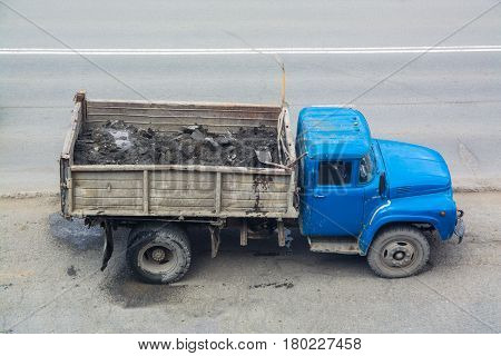 Old truck with a blue cabin. Top side view.