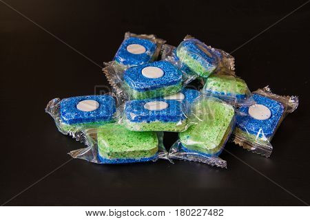 Tablets for Dishwashing Machine on a Black Background. Tablets In a pack.