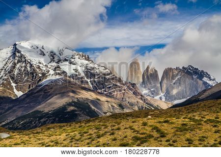 Summer in the south of Chile. The famous Torres rocks in Torres del Paine National Park. The concept of extreme and active tourism