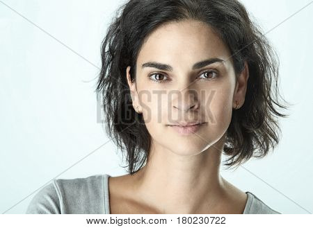 Close-up portrait of beautiful adult woman on white background.