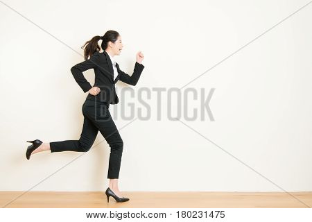 Young Businesswoman With Running On White Background