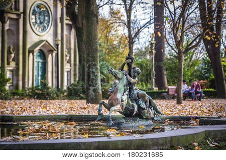 Small pool and Chapel of Carlos Alberto in Crystal Palace Gardens park Porto Portugal