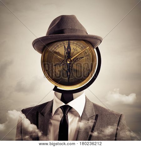 Man with a vintage compass as head. business orientation and indications concept.