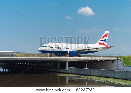 SCHIPHOL NETHERLANDS - JUNE 4 2016: British airways airplane taxiing to the runway on amsterdam schiphol airport