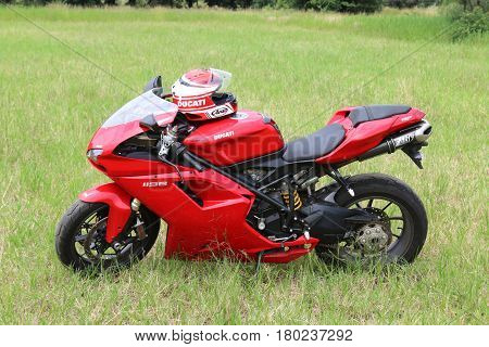 Parked Red Ducati 1198 Motorbike On Green Grass