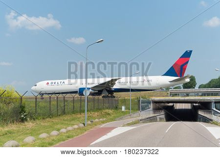 SCHIPHOL NETHERLANDS - JUNE 4 2016: Delta airlines plane taxiing to the runway on schiphol airport