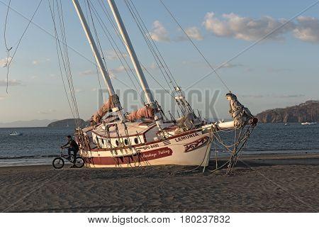 PLAYAS DEL COCO, COSTA RICA-MARCH 08, 2017: Stranded sailboat at the Playas del Coco in Costa Rica