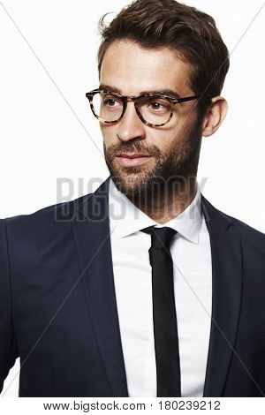 Seriously suited man in glasses studio studio shot