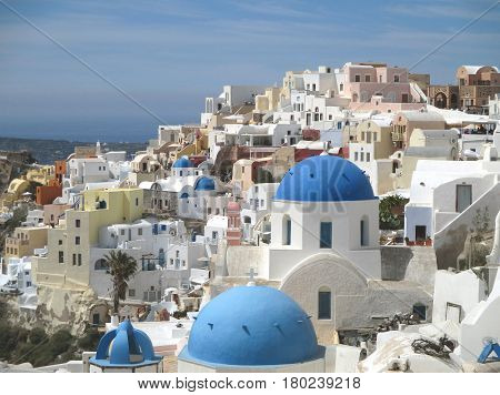 The famous white and blue Greek Islands style architecture of Oia village, Santorini island, Greece