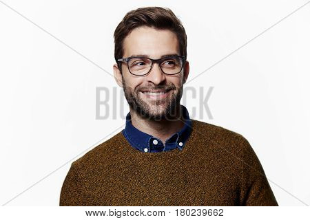 Happy chap in sweater and spectacles studio