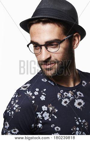 Trilby hat man in floral t-shirt studio shot