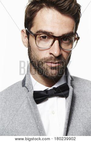 Glasses and bow tie guy portrait studio shot
