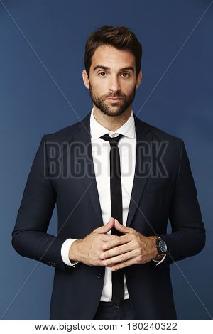 Man with stubble in smart suit portrait