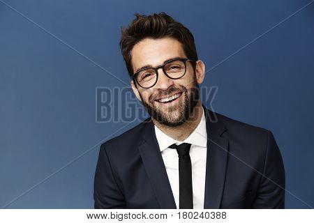 Happy chap in suit and glasses portrait