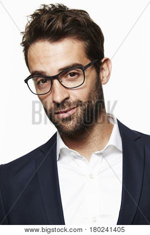 Spectacled guy in suit portrait studio shot