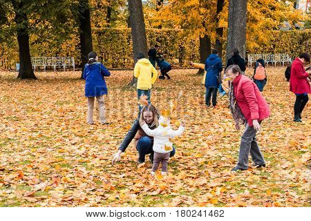 ST. PETERSBURG RUSSIA - OCTOBER 02: People play in the Indian summer in Pushkin RUSSIA - OCTOBER 02 2016. In suburbs of St. Petersburg in parks very beautiful fall.