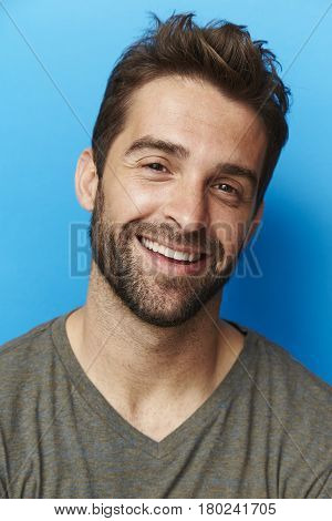 Stubble guy in grey portrait studio shot
