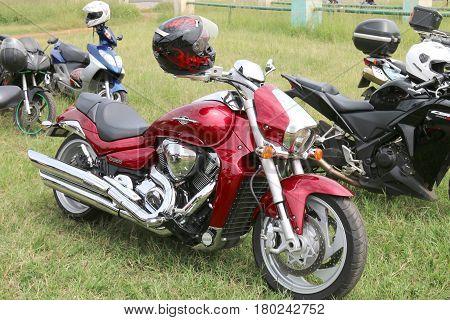 Parked Red Suzuki Boulevard M109R Motorbike On Green Grass