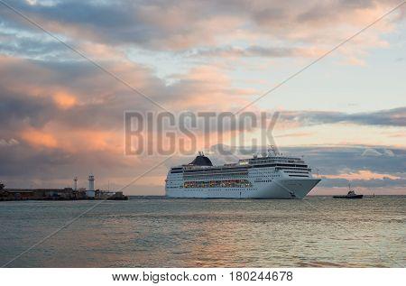 Big ship evening sailing off from Yalta port Crimea Ukraine.