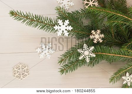 New Year's still-life with flowing trees аnd wooden snowflakes.