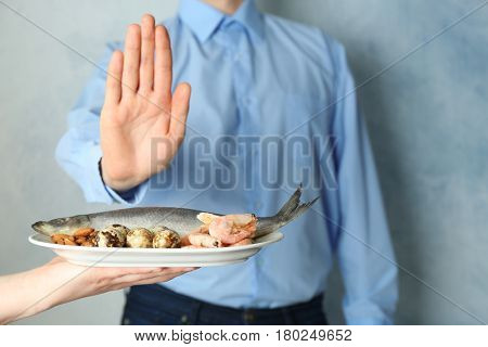 Allergy concept. Young man refusing to eat food