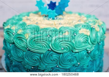 Cyan and blue one layer birthday cake with edible marzipan stars