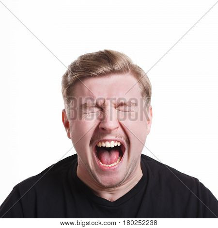 Feeling furious. Man expressing anger, shouting loudly on white isolated background, studio shot