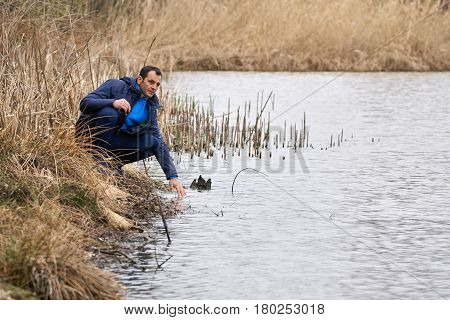 Mature Man By The Lakeside