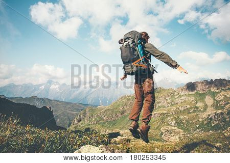 Happy Man jumping levitation with heavy backpack at mountains Lifestyle Travel emotional euphoria success concept adventure active vacations outdoor