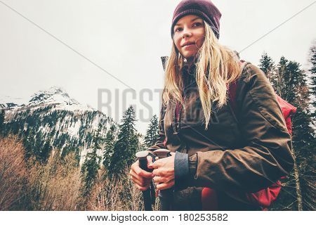 Blond Woman hiking at forest mountains Travel Lifestyle concept adventure summer vacations outdoor mountaineering with backpack alone into the wild