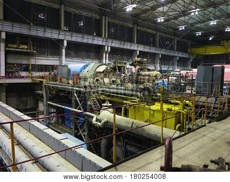 Steam turbine during repair machinery pipes tubes at a power plant night scene