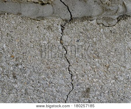 A Crack In The Concrete Wall. The Destruction Of The Wall From The Gray Blocks