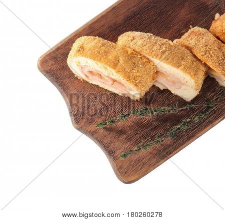 Wooden board with tasty chicken sliced roll on white background