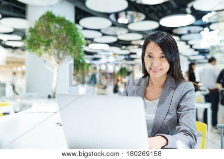 Businesswoman woking on laptop computer in meeting room