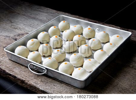 Dessert Chinese Pastry.The dough for pastry making in baking tray on wooden