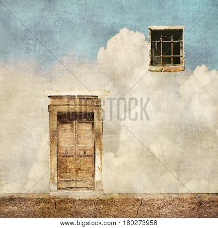 Surreal landscape with old door and window on cloudy sky